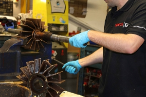 Fitter working on Speck pump repair
